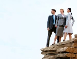people on a cliff edge